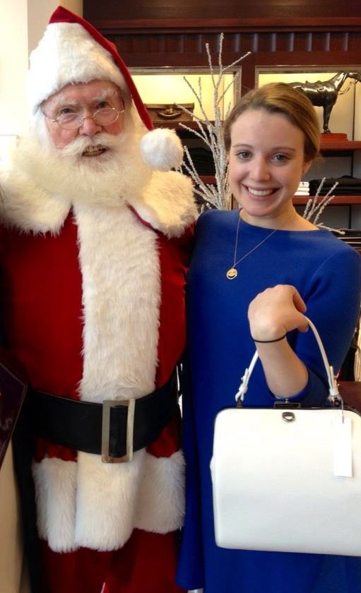 My wonderful associate Caitlin, holding out Lady Jane in Ivory Goatskin for her special visit with Santa. Wondering what special gift she asked for, as how often is it as an adult we get to visit Santa Clause! Hope it was a good one, Caitlin!
